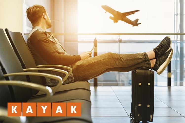 Kayak logo with man seated at airport
