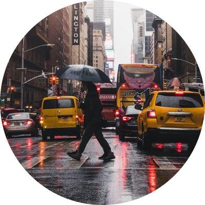 Rainy New York street with taxis